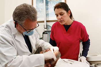 Patient in the Bronx receiving dental implants at East Tremont Dental